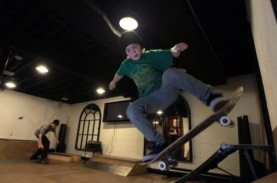 Myles Underwood, shown riding with Daniel Crane (left) in his family's basement. and his mother, Patty, are lobbying for a skate park in Brookline.