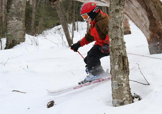 Seven-year-old Willy Egan skis through the trees at Sugarbush Resort.