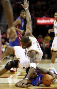 Cleveland's Antawn Jamison loses the ball after a run-in with Detroit's Ben Gordon.