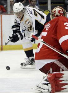 Sergei Kostitsyn scores Nashville's fourth goal against Detroit on the way to a 4-1 win in Joe Louis Arena.