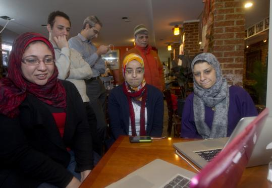 From left seated, Dina El-Zanfaly, Amira Hussein, and Lamya Youseff, along with Tamer Elkholy (standing, left), Islam Hussein, and Sammt Herbawi, followed the news in Egypt yesterday.