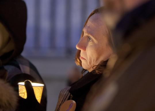 Diane Moulton took part in a vigil. Her stepdaughter was killed in a group home.