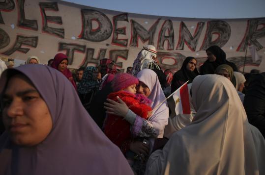 A woman hugged her daughter in Cairo's Tahrir Square yesterday, hours before Hosni Mubarak resigned as Egypt's president.