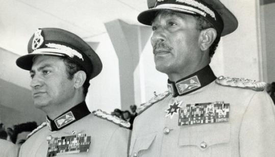 The late Egyptian President Anwar Sadat, right, and then-Vice President Hosni Mubarak attend a ceremony.
