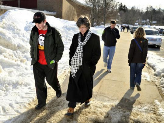 Anders Johnson and his mother, Mary, of Hamilton returned to their car after it was announced that February school vacation would be canceled.