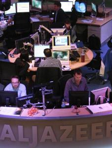 Employees of the English-language satellite news channel Al Jazeera work in the control room in Doha, Qatar. The Egyptian crisis may provide the news channel its best chance yet to capture a larger share of the US audience.