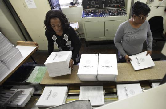 Workers at the Government Printing Office at Washington prepared copies of the proposed 2012 federal budget, which President Obama will send to Congress today.