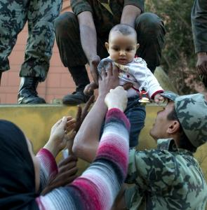 A woman photographed her son with soldiers in Cairo's Tahrir Square yesterday. Most of the protesters had headed home.