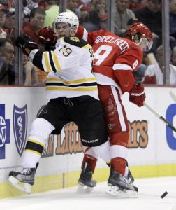Bruin Tyler Seguin is checked by Red Wings winger Justin Abdelkader in the second period.