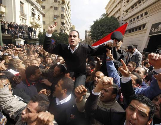 Police officers took part in a protest demanding higher wages in front of the Interior Ministry building in Cairo yesterday.
