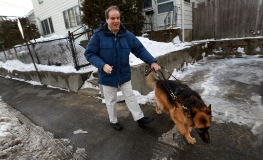 Bob Hachey of Waltham with his guide dog, Xane. Hachey, who is currently unemployed, says he has given up hope of ever owning his own home.