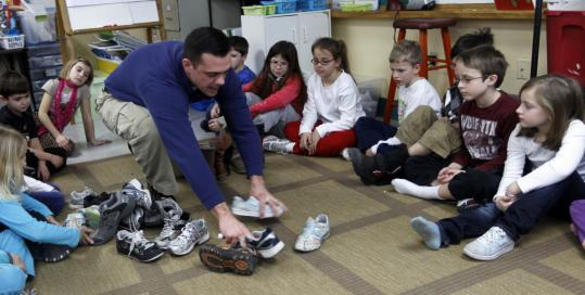 Scott Santino, a Mass. Audubon Ipswich River Wildlife Sanctuary naturalist, brings a lesson to students at the John C. Page School in West Newbury.