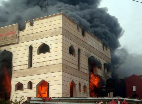 Flames engulfed the Wasit Provincial Council building in Kut, in Wasit Province, as some 2,000 Iraqis demanded the provincial governor's resignation and protested poor basic services.