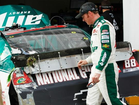 Dale Earnhardt Jr. surveys the damage after a practice crash bumped the pole winner to the back of the Daytona 500 field.