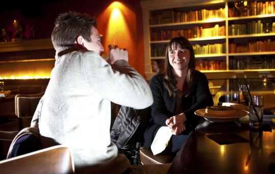 Andrew Berg and Gabriella Burnham enjoy drinks at the bar of 94 Mass Ave.