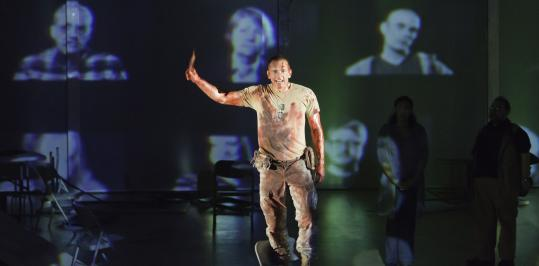 "Brent Harris plays the title role in the American Repertory Theater's production of ""Ajax,'' which uses a Greek chorus of Boston-area residents on video screens."