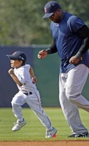 """Big Papi'' David Ortiz takes a jaunt around the field, with ""Lil Papi'' — his son D'Angelo — leading the way."