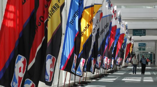Flags representing the NBA's franchises adorn the Los Angeles Convention Center as the city prepares for the weekend festivities.
