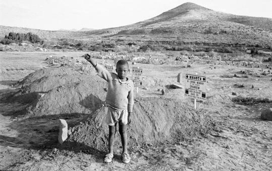 David Goldblatt's images from South Africa are as much about the land as they are about the people. Pictured: 'A child's salute to the Cradock Four.'