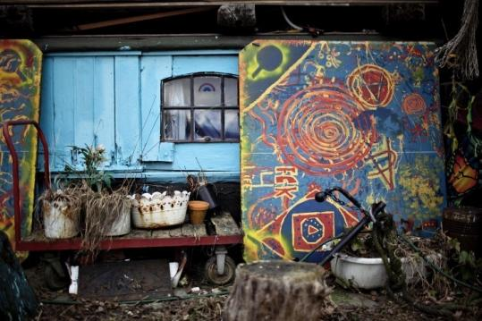 """The Danish government wants to """"normalize'' the four-decade old neighborhood of Christiania, built on an old naval base."""