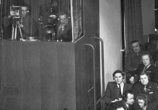 Raymond D'Addario (left) in position at the Nuremberg trials.