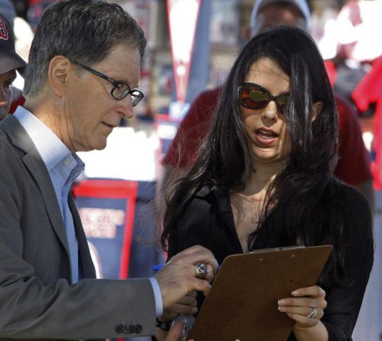 Red Sox owner John Henry and his wife, Linda Pizzuti Henry, iron out some details on Day 1 of full-squad workouts.