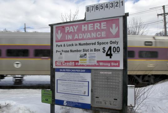The T introduced a pay-by-phone system as an alternative to the cash boxes in use at many commuter rail stations.