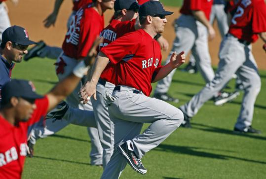 J.D. Drew does morning exercises during the Red Sox' first full-squad workout of the spring.