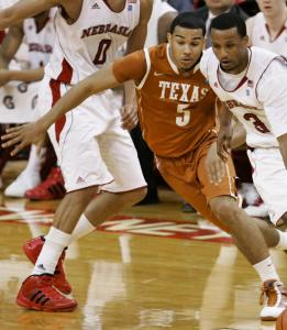 Brandon Richardson, who would later hit the clinching free throws, evades Texas's Cory Joseph.