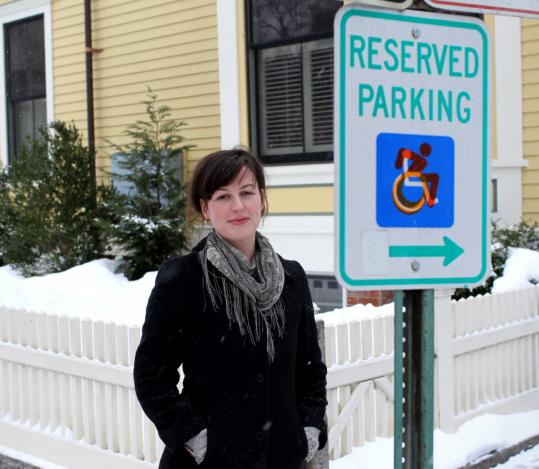 Cambridge artist Sara Hendren is sticking her modified handicapped symbol over the standard sign image.