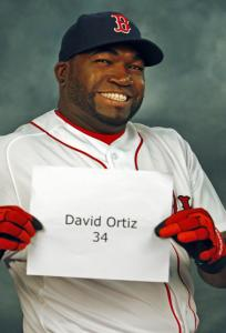 Sox designated hitter David Ortiz mugs it up before having a still picture taken during photo day.