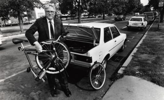 Harry Montague with one of his creations. Montague foldable bikes are sold in 24 countries.