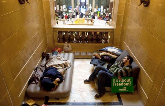Protesters seeking to protect collective bargaining rights for public unions slept in the state Capitol in Madison, Wis., yesterday.
