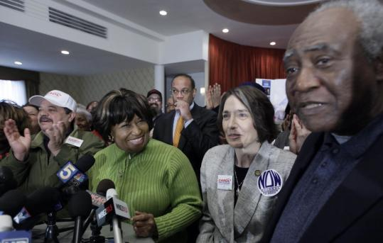 Chicago mayoral candidate Carol Moseley Braun smiled at US Representative Danny Davis (right) at a rally yesterday. Braun, a former US senator, is one of six people on today's ballot.