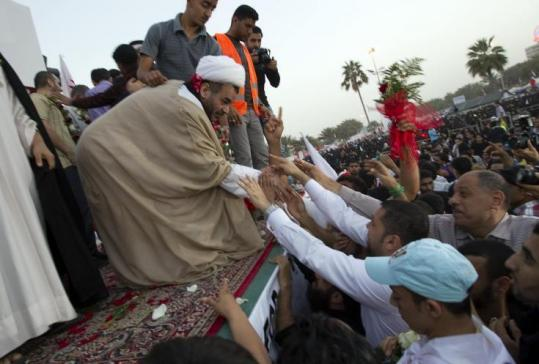 Cleric Sheikh Mohammed Habib Muqdad, one of the political prisoners released by the king of Bahrain, shook hands with supporters at Pearl Square in Manama yesterday.