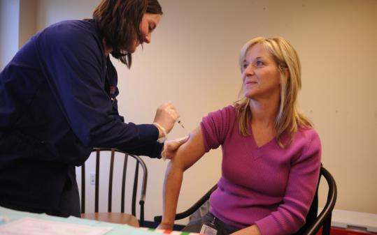 Nursing student Kate Carpenter administered measles vaccine yesterday in Park Square to Annie Barker of Holbrook.