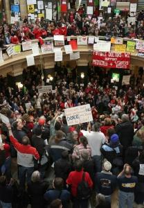 Demonstrators fill the rotunda of the state capitol yesterday in Madison, Wis.