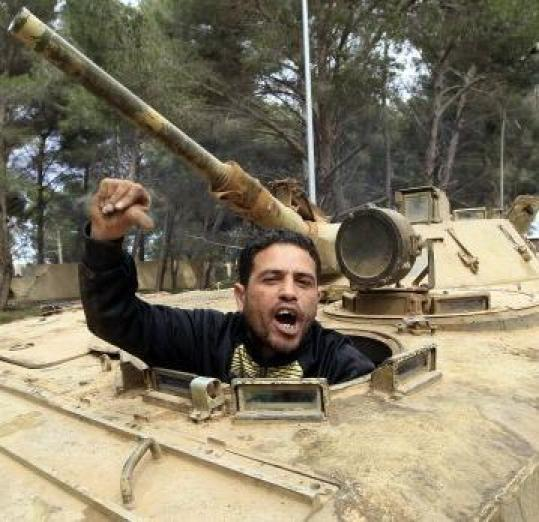 A man sat in an armored vehicle in the eastern Libyan town of Shahat yesterday.