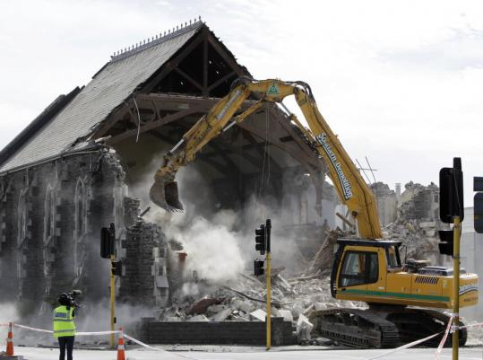 A church damaged in Tuesday's 6.3-magnitude earthquake in Christchurch, New Zealand, was demolished yesterday. At least 113 people, including two infants, were killed in the disaster.
