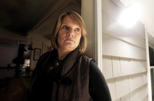 Jeannie McDonough stood at the back door entrance used by serial killer Adam Leroy, who walked into the first floor bedroom where McDonough's daughter, Shea, slept and tried to attack her July 30, 2007.