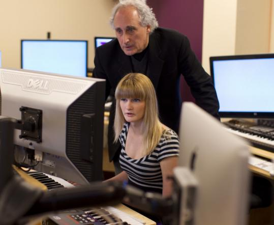 Professor Richard Davis works with Alexandra Zwart to demonstrate the film scoring process. The Berklee student is involved in a project cataloging Paramount Pictures' film music.