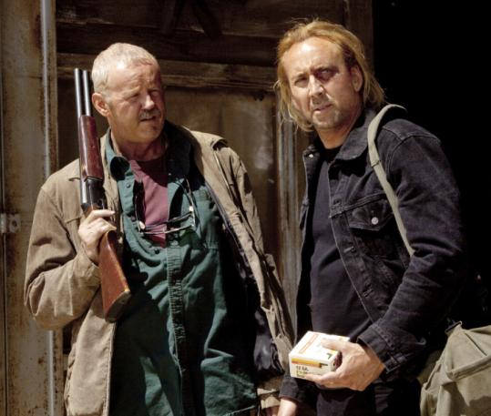 "David Morse (left) and Nicolas Cage in the action film ""Drive Angry.''"
