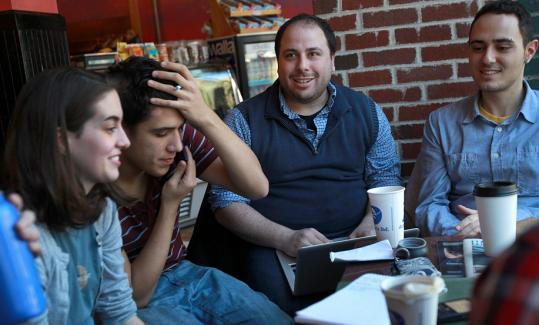 Caleb Jonas (second from right) is getting help in his drive from Kate Leist and Sam Novey, both Harvard students, and Frank Marino from Northeastern.