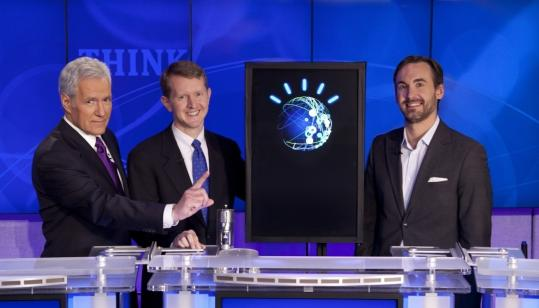 Watson took on &#8220;Jeopardy!&#8217;&#8217; champions Ken Jennings (center) and Brad Rutter (right), winning two of its three games and the $1 million prize. The contestants are shown with host Alex Trebek.