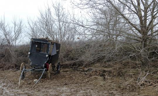 A tattered buggy that overturned in a flooded creek stood in a field near Dublin, Ky. Four children were swept to their deaths.