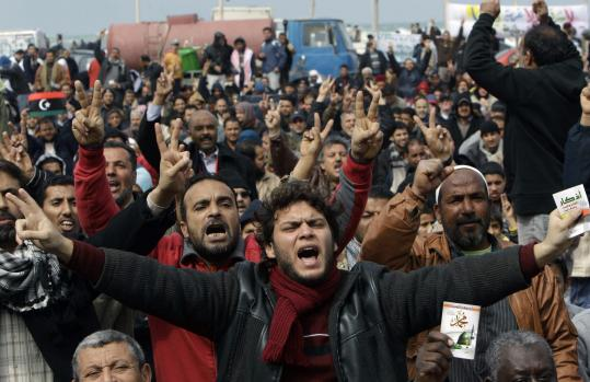 Libyan protesters shouted slogans against Moammar Khadafy as tens of thousands demonstrated yesterday in Benghazi, Libya.