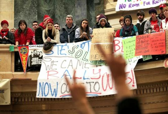 Demonstrators rallied in the Capitol rotunda in Madison, Wis., yesterday, the 12th day of an occupation protesting Governor Scott Walker's support of bill against collective bargaining.