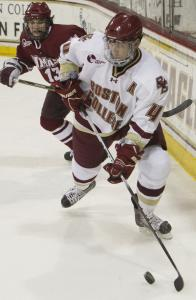 UMass forechecker Conor Sheary is in hot pursuit of defenseman Tommy Cross in the BC zone in the second period.