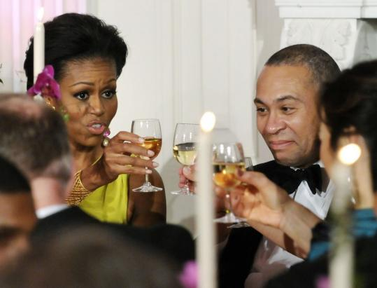Michelle Obama shared a toast with Massachusetts Governor Deval Patrick at a dinner for the National Governors Association at the White House in yesterday.