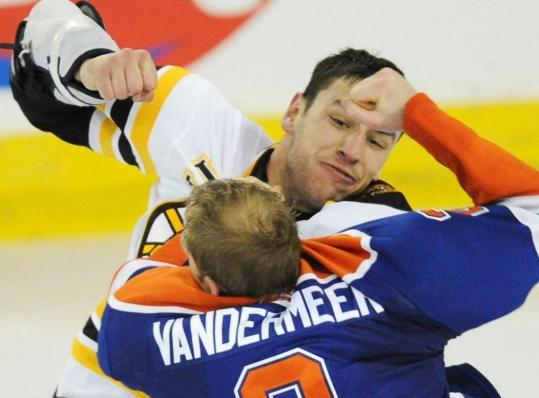Bruin Milan Lucic provided offensive punch, then squared off against Jim Vandermeer.